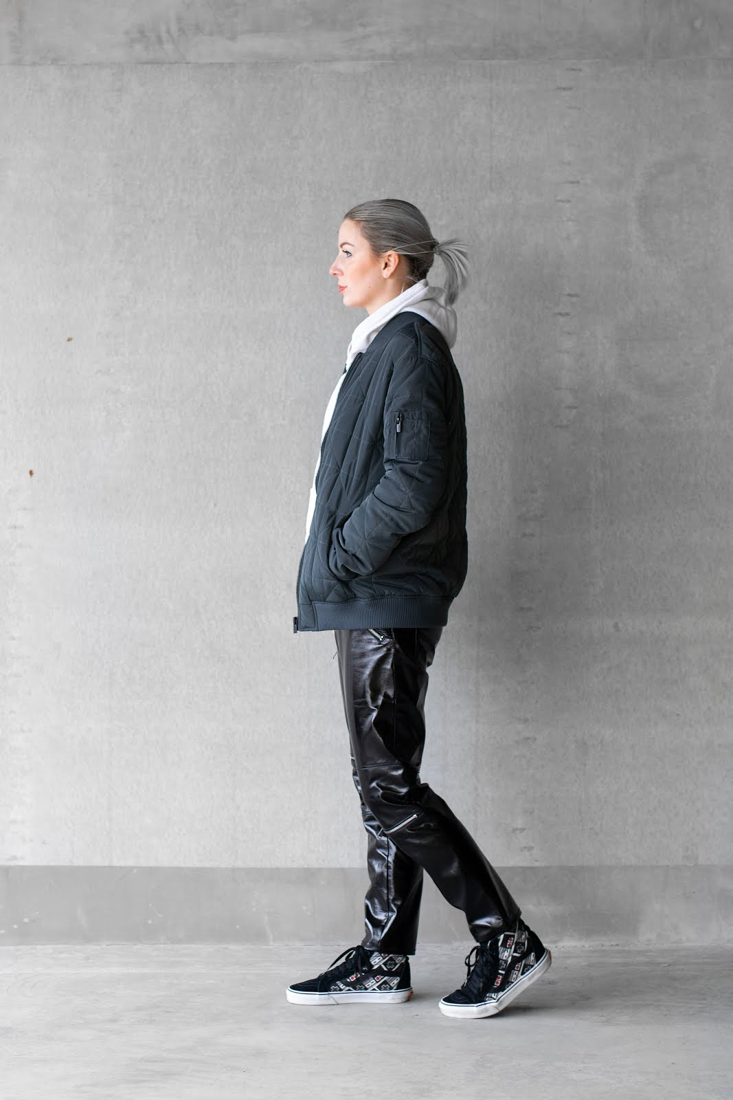 The sting bomberjacket dark grey, h&m studio white hoodie 2016, patent, high shine trousers pants zara, vans super nintendo sneakers, minimal outfit, street style
