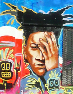 mural image of black man with hand on face