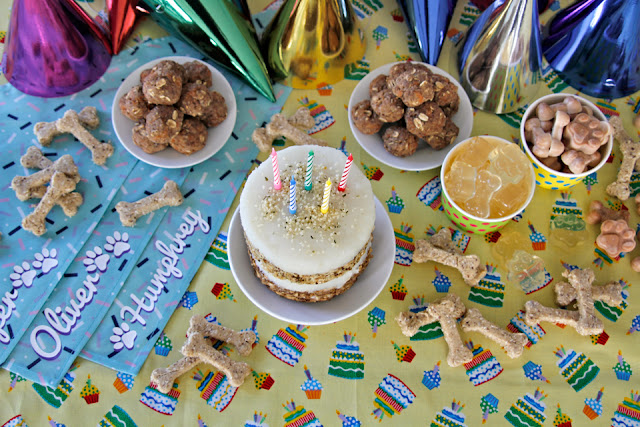 Dog birthday party buffet table with birthday cake and treats