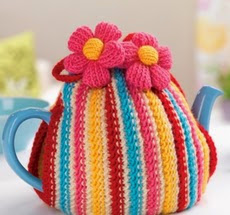 http://www.letsknit.co.uk/free-knitting-patterns/colourful_teacosy