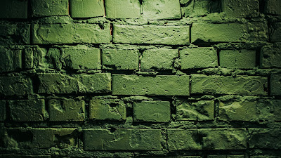 Green wall, bricks, wooden table, lamp, lighting