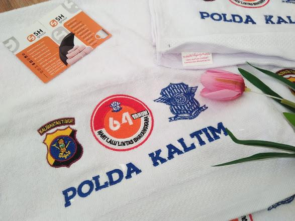 souvenir promosi handuk bordir pesanan Polda Kaltim