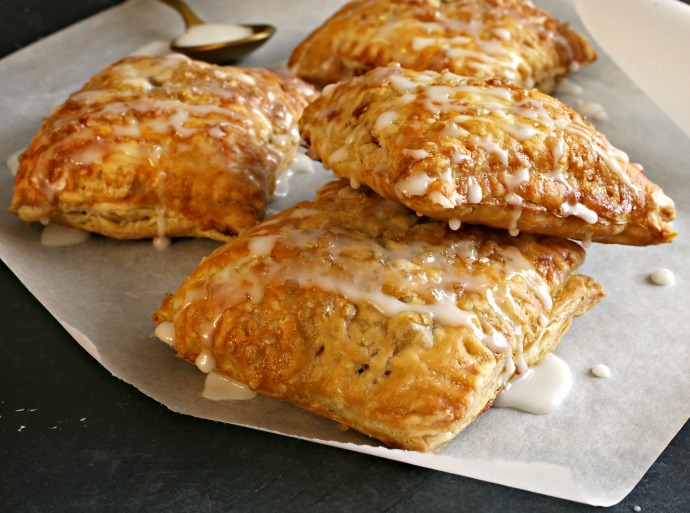 Recipe for apple turnovers in puff pastry with a sweet sugar glaze.