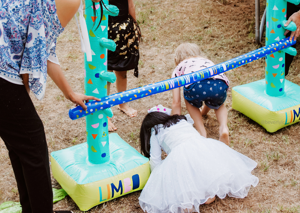 Kids playing with a inflatable limbo from kmart Australia