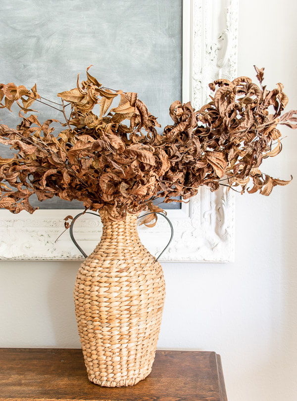 dried leaves in a basket vase