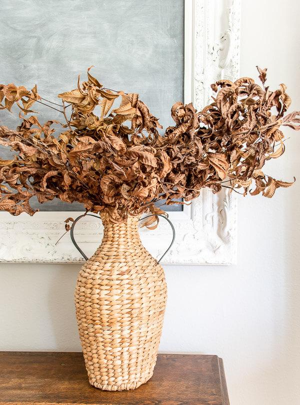 dried leaves in a basket vase