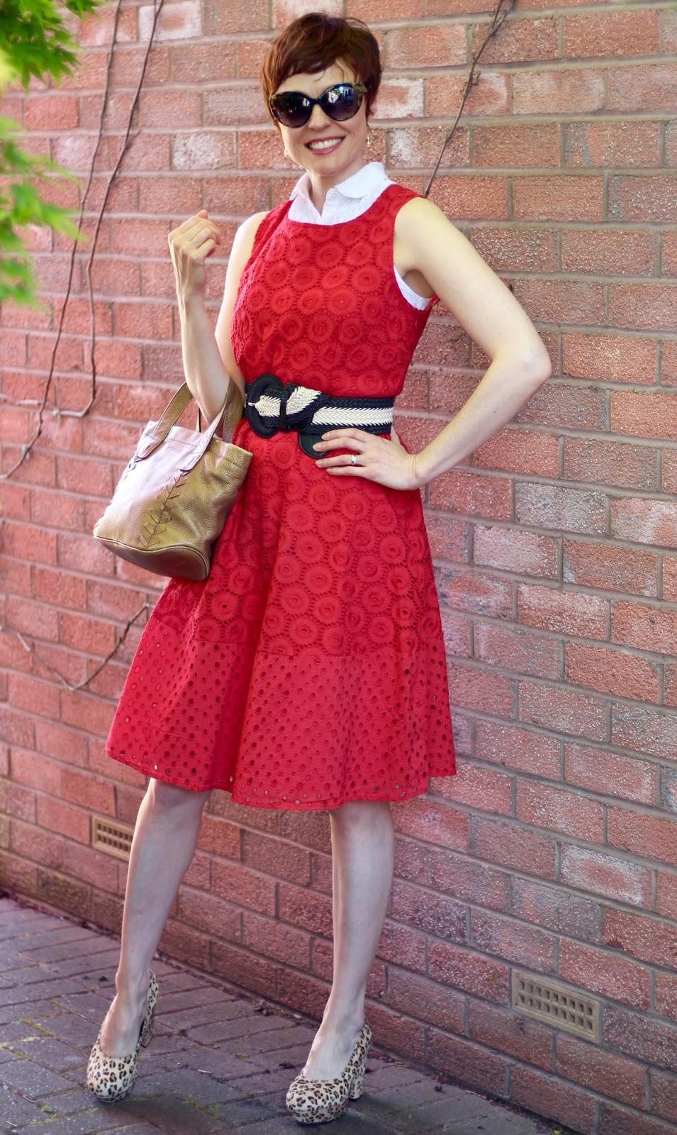 White sleeveless shirt under a red dress, leopard platform shoes & Black& white belt | Over 40