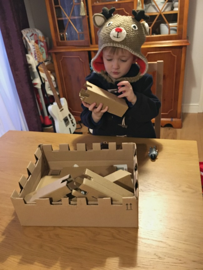 Our-Weekly-Journal-Naughty-and-Nice-boy-with-cardboard-castle