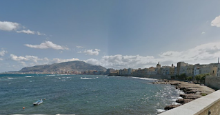 A sweeping view of the bay on which sits the picturesque port of Trapani