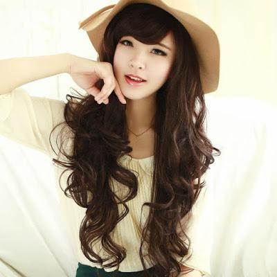 Model Rambut Keriting Gantung Panjang Untuk Wajah Bulat ...