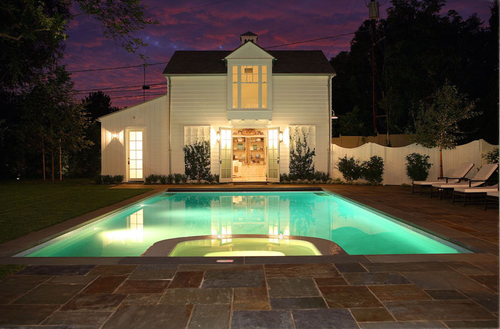 Night shot of pool house and pool at Brentwood traditional home by Giannetti