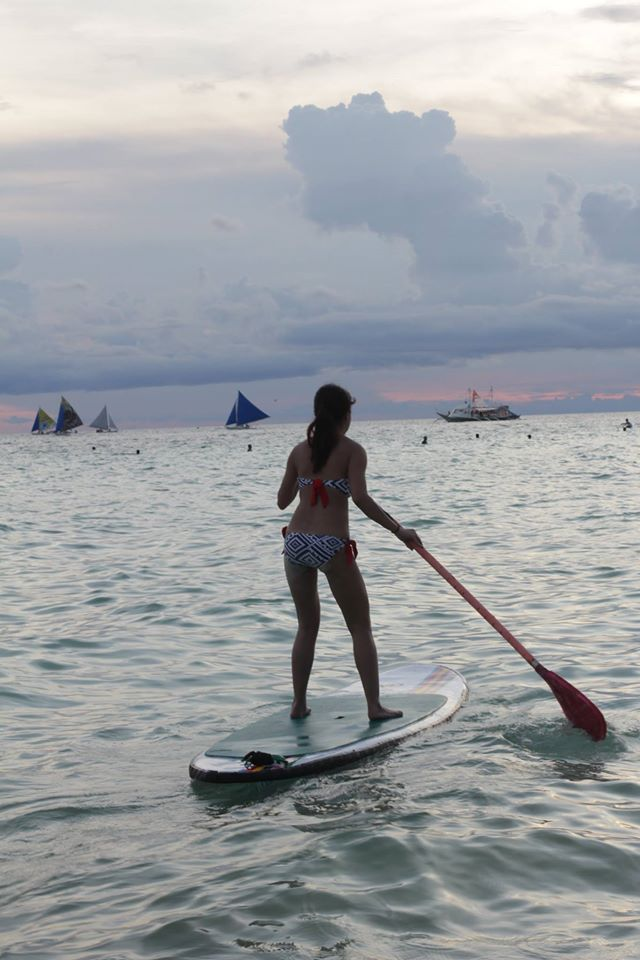 sunset stand-up paddle activity
