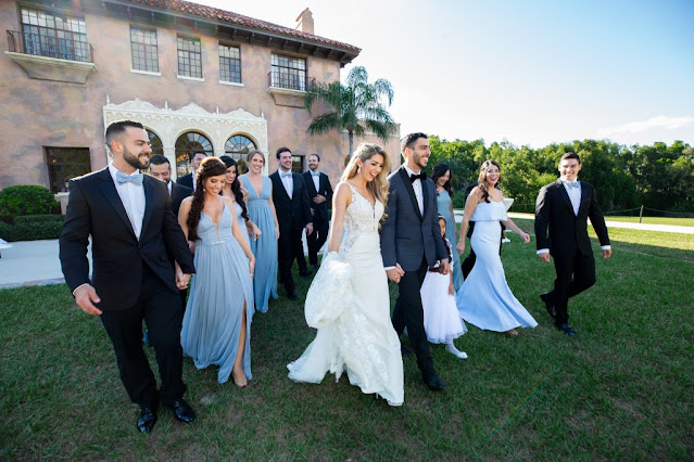 bridal party walking in front of the howey mansion