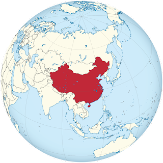 A map of the eastern hemisphere showing China in red at the center.
