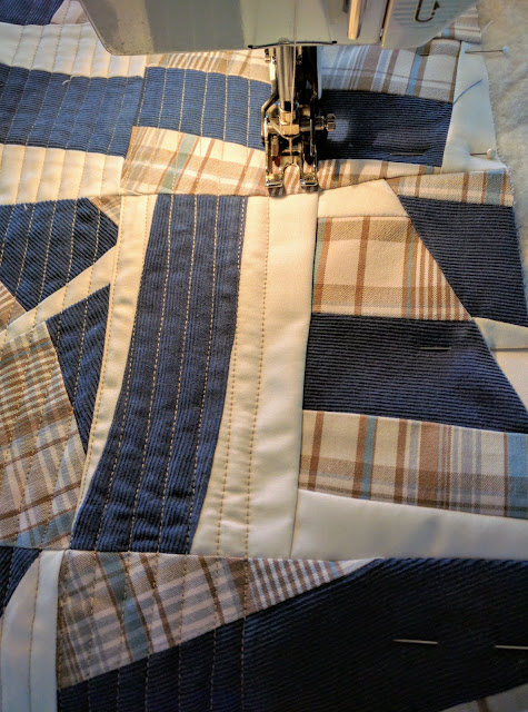 Quilting improv pillow top. Blocks made of three vintage men's shirts.