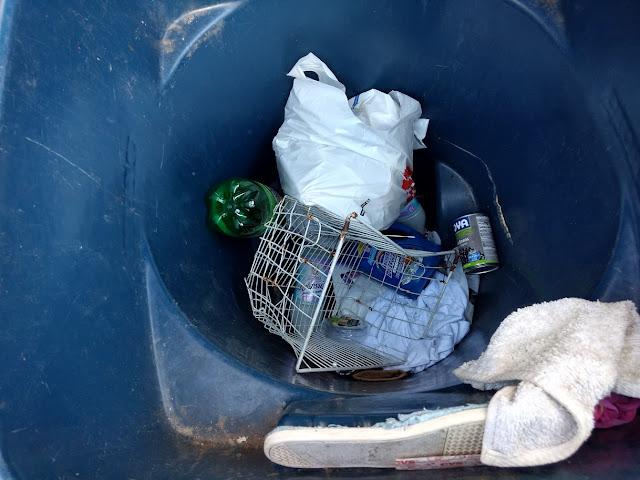 old basket in trash