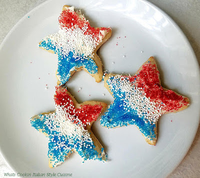 these are called loft cookies. A sugar cookie that can be cut out in many shapes these are red white and blue sprinkles and colored sugar for a Patriotic party