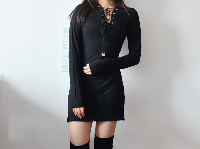 A casual-chic all-black outfit featuring SheIn's lace-up form-fitting long sleeve bodycon shift flared-hem dress, worn with over-the-knee faux suede wedge boots.