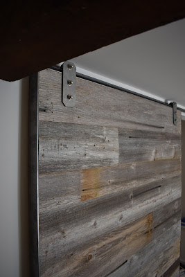 grey reclaimed wood barn door for a heritage home in Vancouver