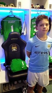 Young fan in the Manchester City dressing room