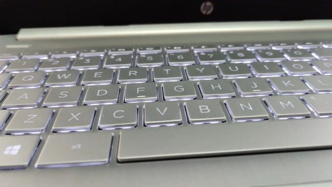A white backlit of this laptop's keyboard.