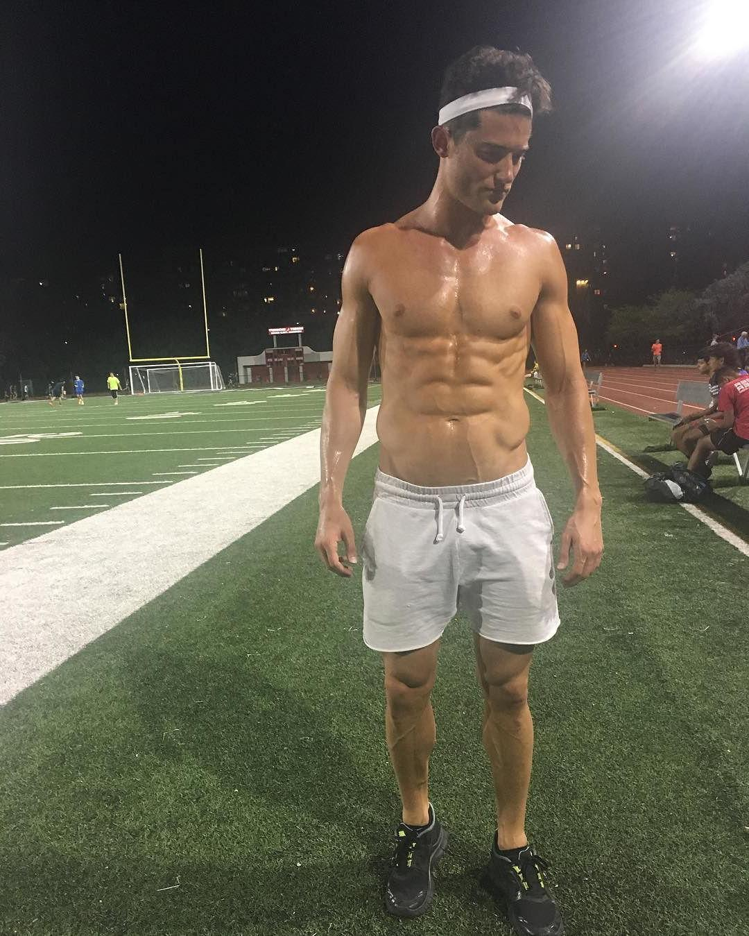 silly-sexy-shirtless-sixpack-abs-college-jock-athlete-sweaty-pecs-green-field