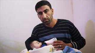 """تخليدا للطائرات التركية المسيرة.. نازح سوري يسمي طفله """"بيراقدار"""""""