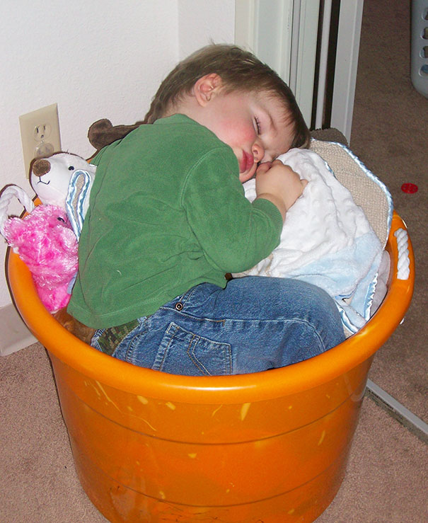 15+ Hilarious Pics That Prove Kids Can Sleep Anywhere - Napping In A Laundry Basket