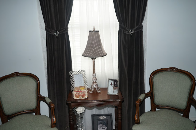 French chairs with antique table with gold lamp