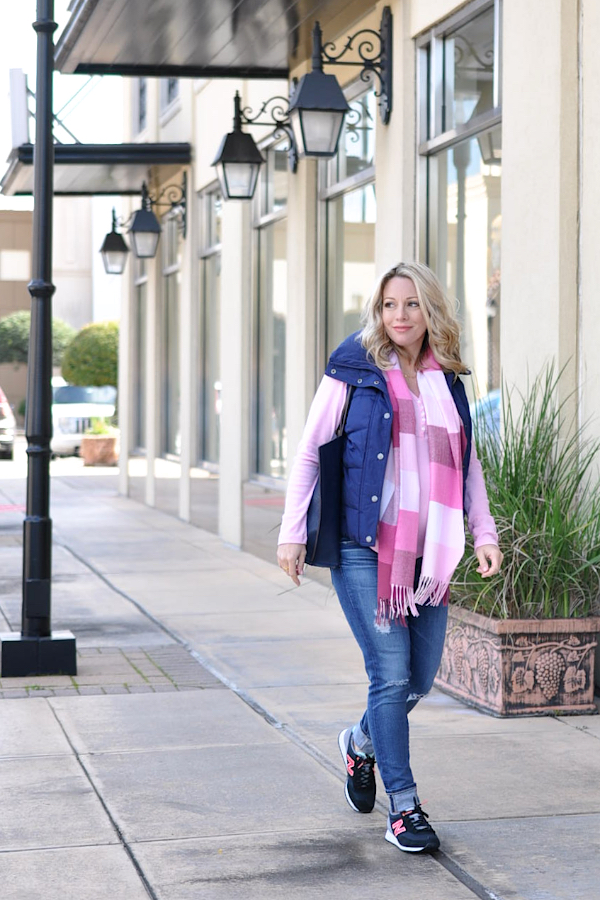 Fall/Winter fashion - distressed jeans, pink top, navy puffer vest and cute sneakers - cute weekend maternity outfit |  #dressingthebump #bumpstyle #maternitystyle