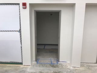 Open doorway in a white wall.