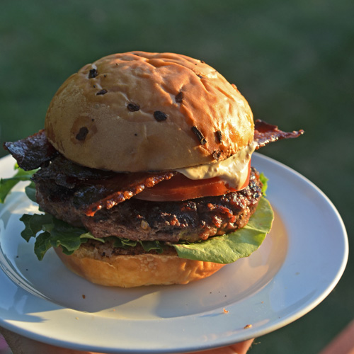 Cheddar burger with brisket jus mayo and candied bacon