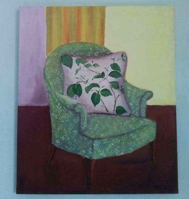 obraz zielony wygodny fotel z białą poduchą w zielone liście