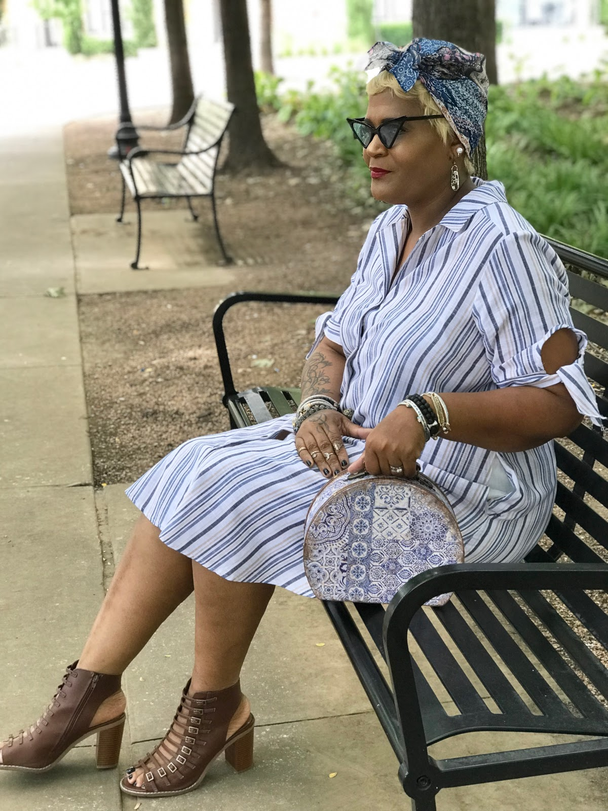 Image: Tangie Bell sitting on bench and sharing her outfits of the day.