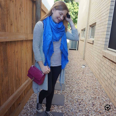 awayfromtheblue Instagram | monochrome outfit with blue louis vuitton shawl and magenta pink edie bag
