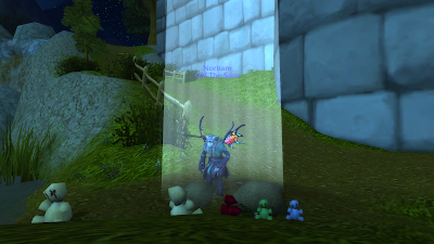 Nor kneeling at a grave, in a beam of light, with 3 stuffed toys placed on the grave site.