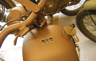 View of top of motorcycle fuel tank with filler cap on.