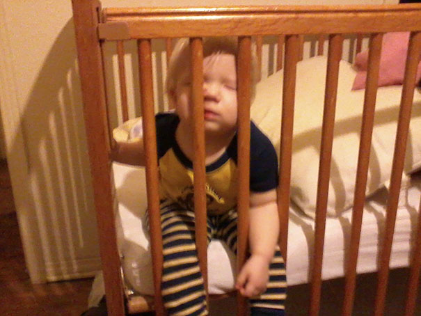 15+ Hilarious Pics That Prove Kids Can Sleep Anywhere - Napping 'behind The Bars'