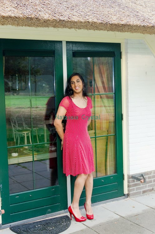 Natassia Crystal natcrys, red polka-dot dress, outside against door