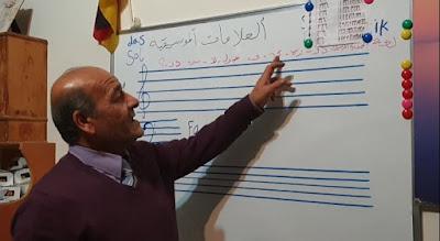 تعليم العزف على آلة العود ( العلامات الموسيقية )