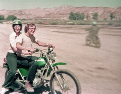Man and woman on motorcycle off road.
