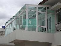 Desain Atap Kanopi Kaca Untuk Ruang Sunroom Idaman