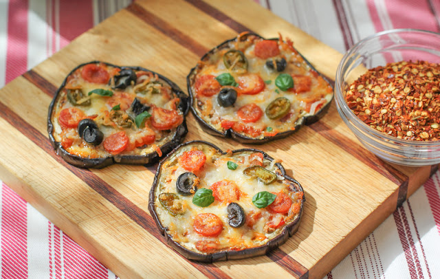 Food Lust People Love: These Toasted Eggplant Crust Mini Pizzas are as delicious as they are adorable with quick tomato sauce and toppings baked on toasted eggplant slices.