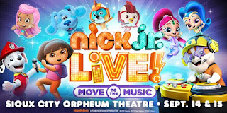 "Nick Junior characters Dora the Explorer, Marshall and Rubble from Paw Patrol, Shimmer & Shine, two birds from Top Flight, Molly from Bubble Guppies, and Blue the dog appear against a blue background. a logo reads ""Nick Jr. Live! Move to the Music"" and at the bottom, text reads ""Sioux City Orpheum Theatre Sep. 14 & 15"""