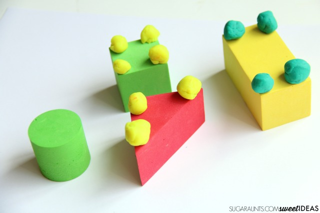 Help kids build their fine motor skills especially precision of grasp and release with this foam block and clay math engineering activity that addresses shapes and vertices.