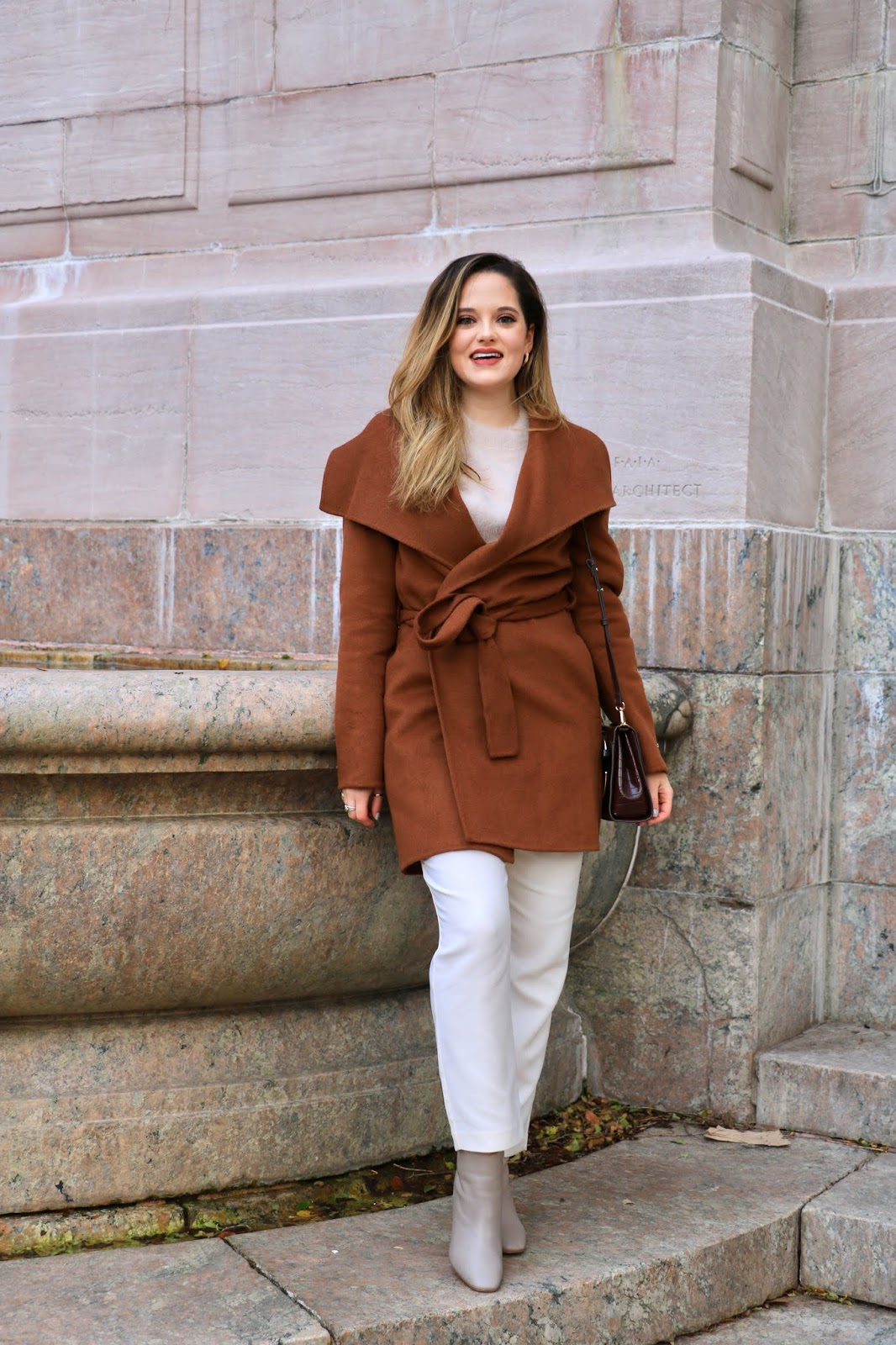 Nyc fashion influencer Kathleen Harper wearing an outfit with an Elie Tahari wrap coat.