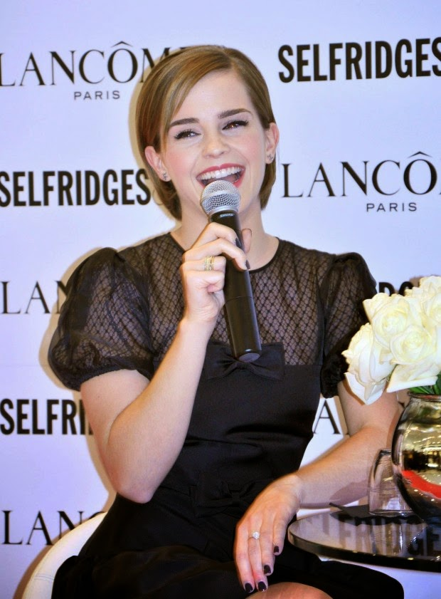 Emma Watson shows off legs in a black mini dress at the launch of Lancome Rouge in Love collection