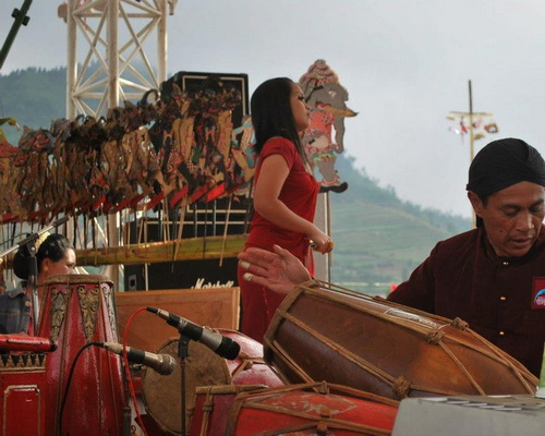 Tinuku.com Travel Dieng Culture Festival, exotic cultural event people in Arjuna temples complex on Dieng plateau each August