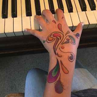 Tattoo hand: LadyD piano student