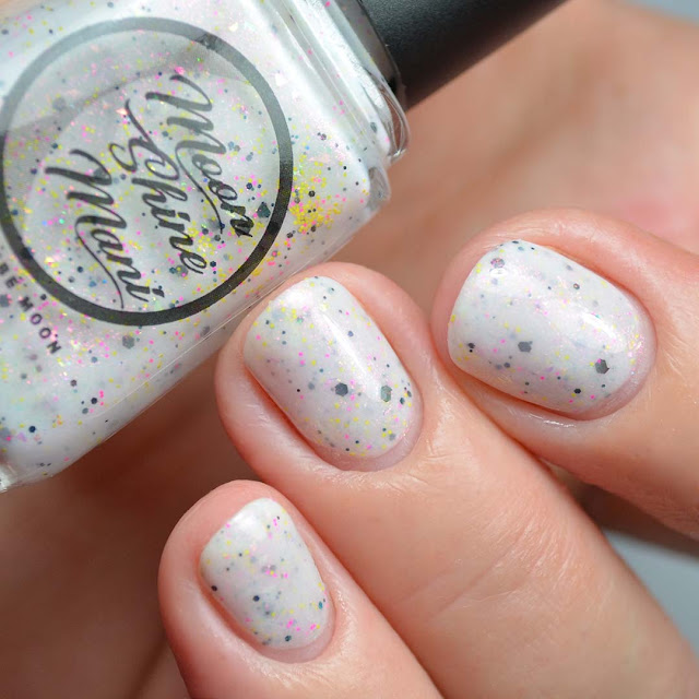 white nail polish with shimmer and colorful glitter swatch